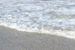 Beach Background. The ocean meets the sand background royalty free stock photography