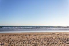 Beach background. Sand, sea and bue sky.  stock image
