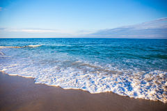 Beach background with sand, sea and sky Royalty Free Stock Image