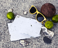 Beach background: shels, sunglusses, coconut Royalty Free Stock Photo