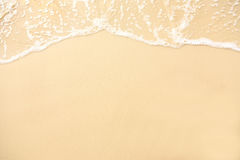 Beach background. Soft wave foam of ocean on sandy beach background Royalty Free Stock Image