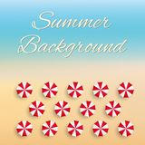 Beach background with sun umbrellas Royalty Free Stock Photo