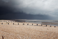 Beach bad weather coast winchelsea england Royalty Free Stock Image