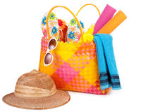Beach bag. With towel sunglasses flip-flops and hat.isolated on white Royalty Free Stock Image