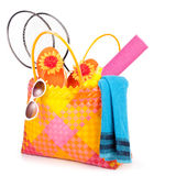 Beach bag. With towel sunglasses flip-flops and hat.isolated on white Royalty Free Stock Photography