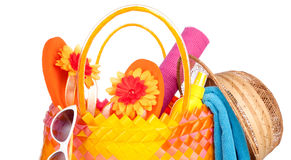 Beach bag. With towel sunglasses flip-flops and hat.isolated on white Stock Photos
