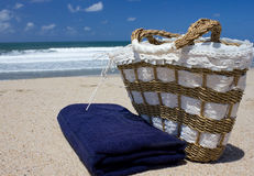 Beach bag. And towel on the sand Stock Images