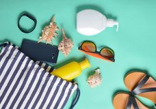 Beach bag and accessories for relaxing on the beach layout on blue pastel background. The concept of the resort at sea, summer time. Top view, flat lay stock photography