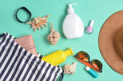 Beach bag and accessories for relaxing on the beach layout on blue pastel background. The concept of the resort at sea. Summer time. Top view, flat lay stock photo
