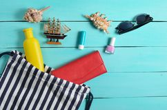 Beach bag and accessories for relaxing on the beach layout on blue wooden background. The concept of the resort at sea. Summer time. Top view, flat lay royalty free stock images