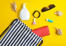 Beach bag and accessories for relaxing on the beach layout on yellow pastel background. The concept of the resort at sea. Summer time. Top view, flat lay royalty free stock photos