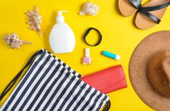Beach bag and accessories for relaxing on the beach layout on yellow pastel background. The concept of the resort at sea. Summer time. Top view, flat lay stock photos
