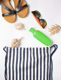Beach bag and accessories for relaxing on the beach layout on white background. The concept of the resort at sea, summer time. Top view, flat lay, minimalism royalty free stock images