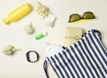 Beach bag and accessories for relaxing on the beach layout on white background. The concept of the resort at sea, summer time. Top view, flat lay, minimalism stock photography