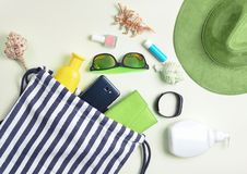 Beach bag and accessories for relaxing on the beach layout on white background. The concept of the resort at sea, summer time. Top view, flat lay, minimalism royalty free stock photography