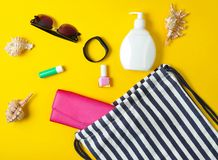 Beach bag and accessories for relaxing on the beach layout on yellow pastel background. The concept of the resort at sea. Summer time. Top view, flat lay stock image
