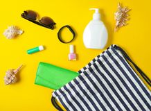 Beach bag and accessories for relaxing on the beach layout on yellow pastel background. The concept of the resort at sea. Summer time. Top view, flat lay royalty free stock photography