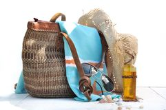 Beach bag with accessories and shells stock photos