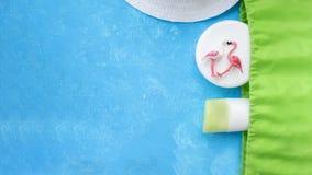 Two flamingos sunscreen bag dia things beach holiday royalty free stock photos