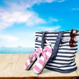 Beach bag. Bag coastal flip-flops coast leisure shore stock photo