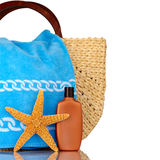 Beach Bag, Blue Towel, Sunscreen,. Straw Beach Bag, Blue Towel, Sunscreen With Water Drops and Starfish Isolated On White Stock Photos