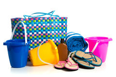 Beach bag with buckets, towel, flip-flops and suntan lotion royalty free stock photos