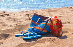 Beach bag and flip flops on the beach Royalty Free Stock Photo