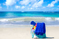 Beach bag with flip flops by the ocean Stock Image