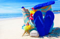Beach bag with flip flops by the ocean Stock Photography