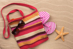 Beach bag with  flip flops, sunglasses and starfish. Stock Photography
