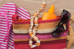 Beach bag with flip flops, sunglasses and starfish. Royalty Free Stock Image