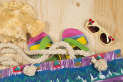 Beach bag, flip flops, sunglasses,  on wooden background. Top view Royalty Free Stock Photography