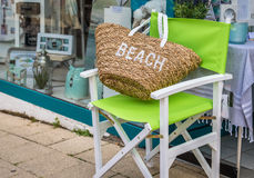 Beach bag on a green Chair. On the street Royalty Free Stock Photo