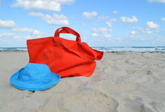 Beach Bag and Hat in the Ocean Sand Royalty Free Stock Images