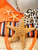 Beach bag and hat with towel and starfish Royalty Free Stock Photography