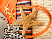 Beach bag and hat with towel and starfish Stock Images