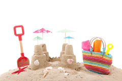 Beach bag in sand. Colorful beach bag with toys at the beach Royalty Free Stock Photos