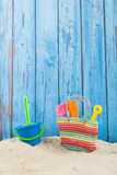 Beach bag in sand Royalty Free Stock Photos