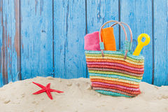 Beach bag in sand. Colorful beach bag with toys at the beach Stock Image