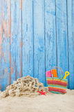 Beach bag in sand. Colorful beach bag with toys at the beach Royalty Free Stock Photography