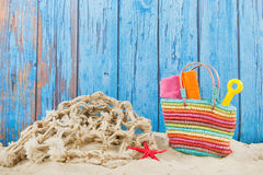 Beach bag in sand. Colorful beach bag with toys at the beach Stock Photography