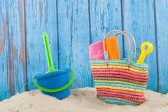 Beach bag in sand. Colorful beach bag with toys at the beach Stock Photos