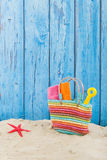 Beach bag in sand. Colorful beach bag with toys at the beach Stock Photo
