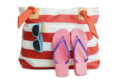 Beach bag with sandal and sunglasses Stock Photos