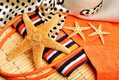Beach bag, starfish, beach hat, towel Stock Photo