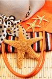 Beach bag, starfish, beach hat, towel Stock Photos