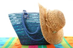 Beach bag with straw hat Stock Photos