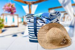 Beach bag with a straw hat sun , towel on. Bag sun hat beach straw hat leisure white Royalty Free Stock Photography