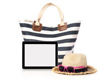 Beach bag, straw hat and tablet. Beach bag, sunglasses, straw hat  and tablet with blank screen, isolated on white Stock Photography