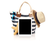 Beach bag, straw hat and tablet. Beach bag, sunglasses, starfish, straw hat  and tablet with blank screen, isolated on white Royalty Free Stock Photos